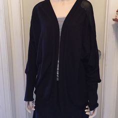 Long cardigan Very long cardigan with loose knit sheer sections on sleeves and across top of back. Band around bottom. Very good condition. Express Sweaters Cardigans