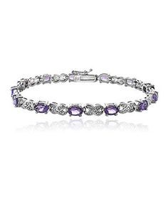 Polish off an outfit with this bracelet to radiate with refined style. Shimmering with exquisite amethysts and luxe sterling silver, it lends ensembles endless shine.