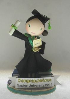 Part of the Custom Order range - this is FaBi DaBis Graduation topper.. this can be ordered with any institute colours, sex, skin colour, and too look like the person its for - for thier full range of dolls and services check out : https://www.facebook.com/fabidabidolls