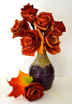Maple Leaf Roses http://www.handimania.com/diy/maple-leaf-roses.html