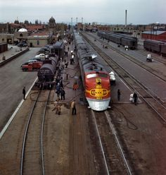 March 1943. Santa Fe streamliner Super Chief being serviced at the depot in Albuquerque. Servicing these Diesel streamliners takes five minutes.