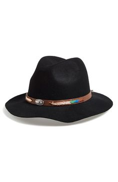 Free shipping and returns on Lulu Fantasia Accessories 'Concho' Felt Panama Hat at Nordstrom.com. A black wool Panama hat adds a touch of intriguing mystery to your look—even if you're just on the corner waiting for the bus. A rustic band adorned with a metallic emblem and colorful embroidery add authentic touches to the tropical style.