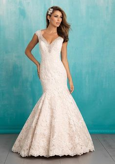 V-neck mermaid wedding dress with beaded cap sleeves and tiered lace train I Allure Bridals I http://knot.ly/6498BXjrK