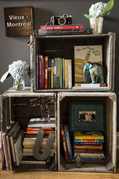 crates used to display books & decor http://www.designsponge.com/2014/05/a-home-designed-to-rival-a-hotel.html#more-196229