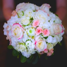 Bridal boquet with ivory and pink roses and rananculas