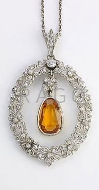 """EDWARDIAN DIAMOND AND TOPAZ PLATINUM NECKLACE Oval pendant in the garland style suspends central pear-shaped precious topaz, 13.4mm x 8.9mm. Pendant: 2"""" x 1 1/4"""", chain: 18"""""""