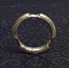 Keith Lo Bue  triad ring 2001    Sterling silver, oxidized; fabricated