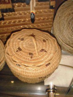 Interior Salish basket woven from split cedar root and cherry bark.