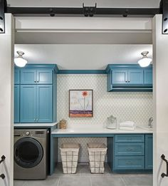 Laundry room doesn't have to be boring. Like this light fixturesShingle Style Home with Casual Coastal Interiors