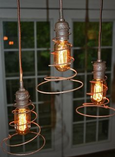 A twist on old bed springs! repurposed rustic decor- added unique element to lighting fixtures. Industrial Lighting, Home Lighting, Lighting Ideas, Porch Lighting, Outdoor Lighting, Edison Lighting, Primitive Lighting, Task Lighting, Rustic Lighting
