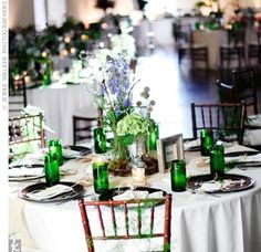 "The couple complemented their vintage vases with water glasses hand-cut from green wine bottles! ""It was a huge job,"" says Julia. ""But I loved seeing them on every table."""