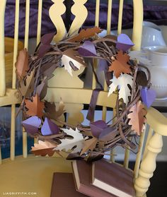 DIY Fall Paper Leaf Wreath.  The combination of these colors are just gorgeous! I printed templates and cut five different leaf patterns from the paper, used my scoring tool to add detail and a center spine which I then folded to add dimension.  Easy as pumpkin pie!