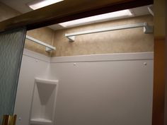 Extra towel bars in shower