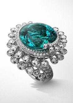 VCA The Tourmaline Ring: 20.44-carat green Paraiba tourmaline wrapped in diamonds set in helical mount.