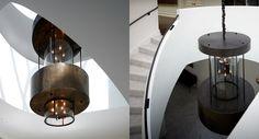Large bronze and curved glass chandelier.deborahoppenheimer.com