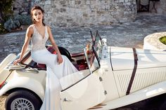 Eddy K Dreams Style Lola.    Striking silver beaded lace top adorns this superb gown.  Colors:  Ivory / Champagne / Skin Ivory / Ivory / Skin       Contact a store and book your appointment today