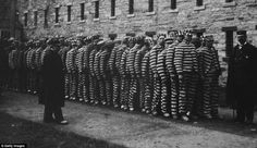 Jacob Riis - Line up: A group of prisoners in striped suits and hats at The Lock-step Penitentiary on Blackwell's Island around 1890