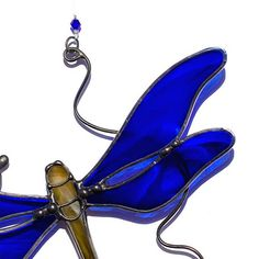 Blue dragonfly, glass dragonfly, stained glass dragonfly suncatcher, garden decoration. This beautiful stained glass dragonfly suncatcher is made of hand cut glass. The pieces are individually cut, ground, wrapped in copper tape and soldered. It comes ready to hang with a sturdy hook