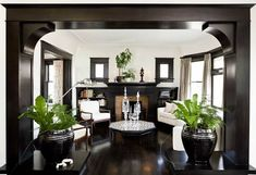 Can't stop being wowed by the glamorous treatment of the dark moldings in this turn of the century house in Portland, designed by Jessica Helgerson, Design Sponge.