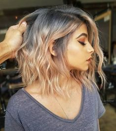 This smoky color starts with charcoal at the roots and blends into gorgeous coral towards the tips of this long straight-cut bob #bobcut