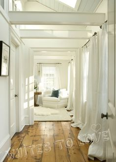white, lots of light. happy space...There is something about all white that pulls my attention...even though I adore color.