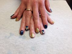 Navy and gold glitter with arrow design  Oasis Salon and Spa Mill Hall Pa (570)726-6565