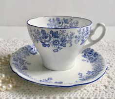 Wonderful vintage Shelley china tea cup and saucer made in England. This lovely duo is in the Rose & Daisy pattern in blue. It is in perfect condition, no chips, cracks or crazing. Please Note: The items I sell are not new, they are vintage or antiques, it goes without saying