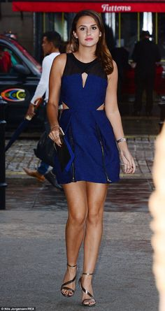 Stunning! Lucy Watson showcases her sun-kissed pins in a striking blue cut-out mini dress ...