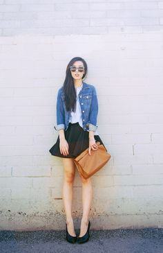 simple denim jacket and classic black skirt with heels