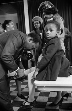 Martin Luther King Jr. with his daughter Bonnie at Ebenezer Baptist Church, Atlanta, February 1968