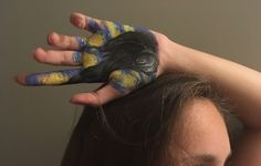 Draw someone with paint on their hand