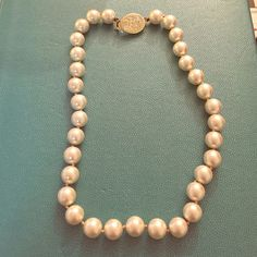 Ralph Lauren pearl necklace good condition, clasp is slightly tarnished, slightly discolored rope tethering the pearls Ralph Lauren Jewelry Necklaces