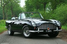 My dream car: 1965 Aston Martin convertible. Recently sold at auction for 500 British pounds. Guess I'll have to start saving. Aston Martin Db5, Classic Aston Martin, Classy Cars, Sexy Cars, My Dream Car, Dream Cars, Jaguar, Vintage Cars, Cars Motorcycles