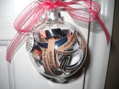 Cute wedding idea - their invitation cut into strips and put into Christmas ornament