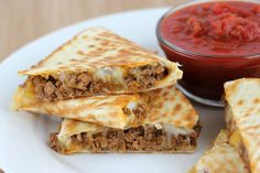 Beefy quesadillas! These quesadillas use a burrito-style filling which consists of taco seasoned ground beef, refried beans, and green chilies.  You can use whatever type of cheese you like but I prefer Mexican cheese blend. These quesadillas go great served with salsa, guacamole, and sour cream. If you are looking for a dinner that is very easy to prepare, this is the one!  Enjoy..
