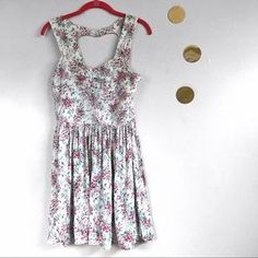 I just discovered this while shopping on Poshmark: LC Lauren Conrad Heart Cutout Back Floral Dress. Check it out! Price: $22 Size: 4