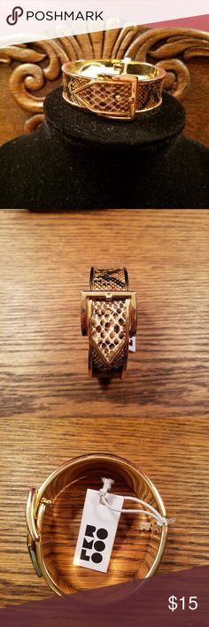 *5 for $15* bracelet Hinged bracelet with buckle type feature for securing it on your wrist. Embossed snake print around the bracket to add a little spunk to your arm candy! *Included in 5 for $15 bundle* Jewelry Necklaces