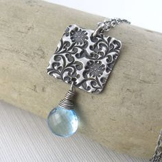 Necklace... Blue Topaz (December birthstone) - Christian. :-)