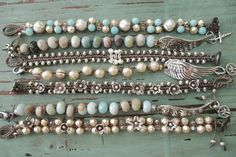 "SALE Silver knotted bracelet Paddles antique by slashKnots $120 Knotted weighty fine silver beads with an antique carved mother of pearl cross button. Several sterling silver paddles move as you move. Perfect for everyday wear to layer with other beaded or leather bracelets you may already own :) Fits an average 6 -6 1/4"" wrist. ha - avg wrist is 6 1/2...so most women could not wear these...anyway its the 3rd one down that is described here"