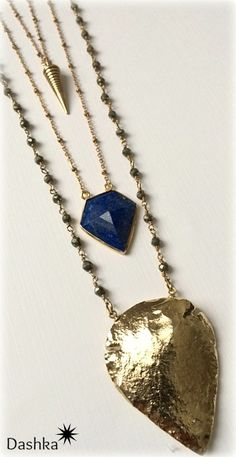 Dashka Jewelry 24K Dip Gold Arrowhead necklace on pyrite rosary chain -$89. Lapis Faceted Pendant on raw brass chain- $42. Raw Brass Industrial Spike Necklace on brass chain -$28.