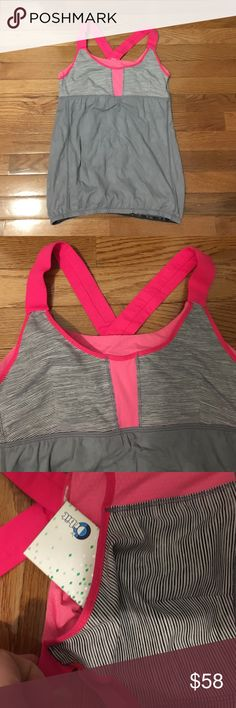 Lululemon Top Lululemon top with built in support and hot pink detailing. Fits a size 6-8. The bust has built in pockets. lululemon athletica Tops Tank Tops