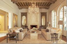 Architect Ken Tate built this sprawling estate near New Orleans. Ceiling beams are lovely rustic influence in this music room. Designer Ann Holden is the daughter of the great interior designer Gerrie Bremermann.
