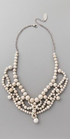 ivory beaded necklace. link doesn't click thru but this is so pretty and interesting without being glittery