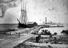 Sailing ship and steamboat at the Green Cove Springs landing between 1878 and 1898.