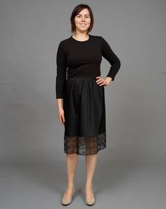 ($16.00)  This classic black slip is a staple for any woman's wardrobe. This slip is so cute it could also pass for a regular summer skirt! This slip is by Barbizon and features lace details along the hem and a subtle black on black polka dot pattern.