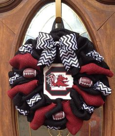 http://www.facebook.com/cutecraftsbyash Made by Ashley Hughes Carolina Gamecock wreath University of South Carolina Black burlap with garnet accents, black and white chevron, footballs