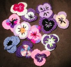 """Debbie had surgery earlier this year for carpal tunnel and reports: """"Crocheting is again my friend – still loving it and sharing it with others! I'm making crocheted pansies at the moment to give out to strangers and place randomly wherever I go, (read The Pansy Project website and you will see where the inspiration comes from), in the hopes that people will ask me what the pansy is for. Even if that pansy puts a smile on someone's face, then something good has come of it."""""""