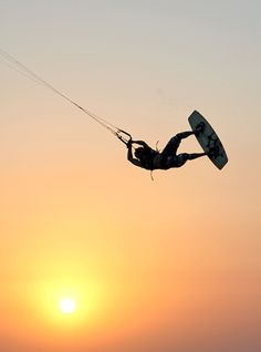 Kiteboarding at sunset at south padre island north flats. For more information about events and deals on SPI, visit www.EnjoySPI.com!