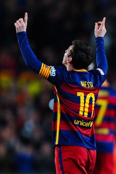 Lionel Messi of FC Barcelona celebrates after scoring his team's first goal during the La Liga match between FC Barcelona and Sevilla FC at Camp Nou on February 28, 2016 in Barcelona