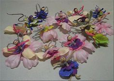 I made something like this for Caroline's Fairy Tea Party.  All you need are silk flower leis from the dollar store, pipe cleaners, and wooden beads for heads.